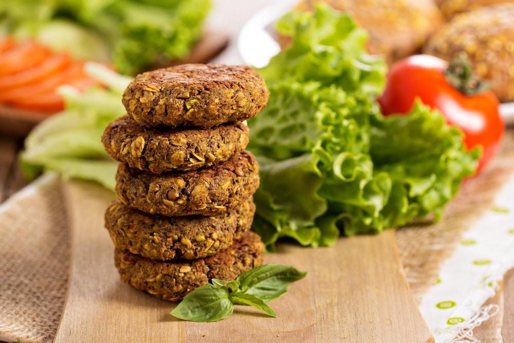 Vegan burgers next to lettece